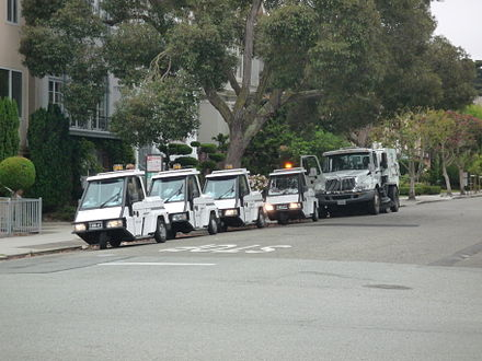 Four parking attendant vehicles and a street cleaning vehicle in San Francisco Street cleaner and four parking attendant vehicles in San Francisco.jpg