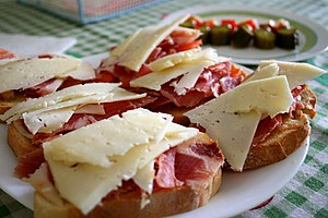 Ham and cheese sandwich - Open-faced ham and cheese tapas-style sandwiches