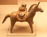 Terracotta figurine of a donkey carrying vessels.jpg