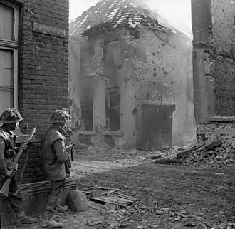 185th Infantry Brigade (United Kingdom) - Men of the 1st Battalion, Royal Norfolk Regiment clearing enemy resistance in Kervenheim, Germany, 3 March 1945.