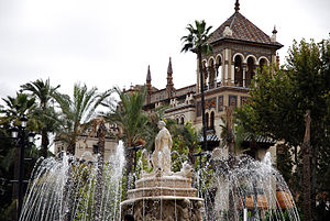 The Fuente de Sevilla fountain at the Puerta de Jerez square (a tower of Hotel Alfonso XIII building in the background). Seville, Andalusia, Spain, Southwestern Europe