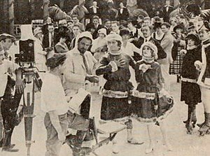 The Goat (1918 film) - Still with casting director Clarence Geldart showing Fred Stone as doubling for Rhea Mitchell