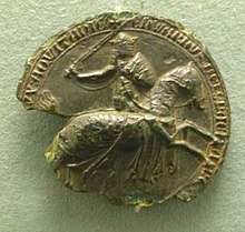 Partly ruined black seal, showing Edward III on horseback, in armour and sword raised