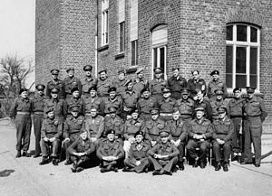 Gordon Holmes Alexander MacMillan - Field Marshal B. L. Montgomery poses for a group photograph with his staff, corps and divisional commanders at Walbeck, Germany, 22 March 1945. Pictured standing in the back row, fifth from the right, is Major General Gordon MacMillan.