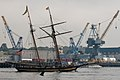 The Pride of Baltimore heads down the Piscataqua River prior to the arrival ceremony for the tall ships..jpg