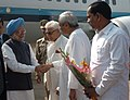 The Prime Minister, Dr. Manmohan Singh being received by the Governor of Orissa, Shri M.C. Bhandare and the Chief Minister of Orissa, Shri Naveen Patnaik, on his arrival, at Bhubaneswar Airport on December 27, 2009.jpg