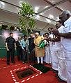 The Prime Minister, Shri Narendra Modi planting sapling to mark the Commencement of Massive Tree Plantation Programme, at Kalaivanar Arangam, in Chennai (1).jpg