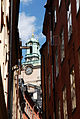 The Tower Of Storkyrkan Cathedral framed with typical Stockholm buildings. Sweden, Northern Europe.jpg