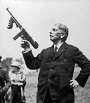 Submachine gun - General John T. Thompson holding a Thompson M1921