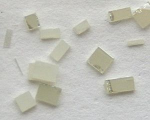Titanium dioxide - Synthetic single crystals of TiO2, ca. 2–3 mm in size, cut from a larger plate.