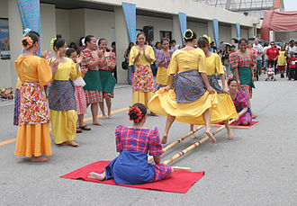 Tinikling - Members from the Philippine Cultural Dancers group perform tinikling