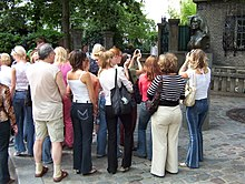 Tourists on the Place Dalida, Paris 15 August 2006.jpg