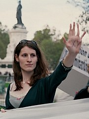 A transwoman with XY written on her hand, at a protest in Paris, October 1, 2005.