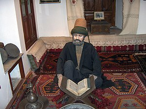 Mevlana Museum - Model of a dervish studying.