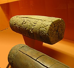 "Two Aztec slit drums, called teponaztli.  The characteristic ""H"" slits can be seen on the top of the drum in the foreground."