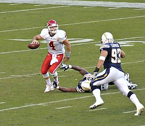 History of Kansas City Chiefs quarterbacks - Tyler Thigpen avoids a sack from Shaun Phillips, 2008.