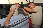 U.S. Air Force Airmen 1st Class Kelle Shadduck, left, and Issac Castellon, munitions systems specialists with the 451st Expeditionary Maintenance Squadron Munitions Flight, install the wing assembly on a bomb 100823-F-OL185-718.jpg