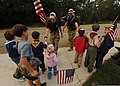 U.S. Air Force Staff Sgt. Danny Wright, Senior Airman Jordan Delbohm and Airman 1st Class Keith Thompson greet members of Cub Scout Pack 221 during the Tim Davis Memorial March in Madisonville, La., Oct. 23 111023-F-PV498-048.jpg