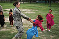 U.S. Air Force Tech. Sgt. Melissa Kemp, a medic with Nangarhar Provincial Reconstruction Team (PRT) based at Forward Operating Base Finley Shields in Jalalabad, Afghanistan, plays with an Afghan girl during 100821-F-FW394-311.jpg