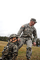 U.S. Army Staff Sgt. Peter King, 1st Battalion, 314th Infantry Regiment, drags a training casualty to safety, during the first-aid lane of a quarterly noncommissioned officer competition at Joint Base 130312-A-WA247-070.jpg