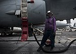 U.S. Navy Aviation Boatswain's Mate (Fuel) 3rd Class Alisia Green refuels an EA-6B Prowler aircraft assigned to Electronic Attack Squadron (VAQ) 142 on the flight deck aboard the aircraft carrier USS Nimitz (CVN 130608-N-LP801-275.jpg