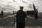 U.S. Navy Lt. Theodore Shields, a Navy chaplain, addresses Sailors during a burial at sea aboard the guided missile destroyer USS Gravely (DDG 107) March 7, 2014, in the Atlantic Ocean 140307-N-DQ840-068.jpg