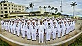 U.S. Navy Rear Adm. Frank Ponds, center, the commander of Navy Region Hawaii and Naval Surface Group Middle Pacific, stands at attention with Sailors at the Pearl Harbor Memorial Fountain during a dress whites 130319-N-RI884-198.jpg