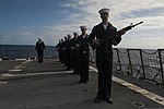 U.S. Sailors aboard the guided missile destroyer USS Gravely (DDG 107) prepare to render a 21-gun salute during a burial at sea March 7, 2014, in the Atlantic Ocean 140307-N-DQ840-167.jpg