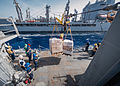 U.S. Sailors aboard the guided missile destroyer USS Stockdale (DDG 106) prepare to receive pallets of cargo during a replenishment at sea with the fleet replenishment oiler USNS Kanawah (T-AO 196) in 130519-N-HN991-147.jpg