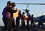 U.S. Sailors assigned to the guided missile destroyer USS Hopper (DDG 70) unload supplies from an MH-60S Seahawk helicopter assigned to Helicopter Sea Combat Squadron (HSC) 26 Dec. 7, 2013, in the Persian Gulf 131207-N-OU681-143.jpg