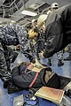 U.S. Sailors examine and treat a simulated patient during a mass casualty drill aboard the aircraft carrier USS Nimitz (CVN 68) 130111-N-HN953-016.jpg