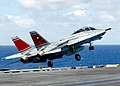 US Navy 020806-N-9593M-029 F-14D launches from carrier flight deck.jpg