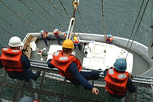Captain's gig - U.S. Navy sailors from USS ''Essex'' (LHD-2) raise their captain's gig out of the sea in August 2002.