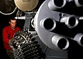 US Navy 041129-N-5345W-036 Aviation Ordnanceman 2nd Class Douglas Vanstrien performs routine maintenance on an M61A1 20mm Vulcan cannon.jpg