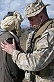 US Navy 050104-M-4697Y-017 Lt. Jeremy Hammel, a Naval Medical Officer assigned to Headquarters and Service Company, 3rd Battalion, 3rd Marine Regiment, checks a local man's heartbeat during a Medcap operation.jpg