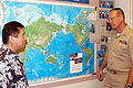 US Navy 050112-N-5039H-002 Principal of Holomua Elementary School in Ewa Beach, Hawaii, Norman K.Y. Pang, left, shows Senior Chief Sonar Technician Lou M. Wills a map.jpg