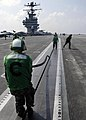 US Navy 050120-N-4166B-079 Sailors from the Air Department place a rubber seal into catapult shuttle number one on the flight deck aboard USS Abraham Lincoln (CVN 72) after launching aircraft.jpg