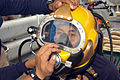 US Navy 050621-N-4104L-022 With the help of U.S. Navy divers assigned to the rescue and salvage ship USS Safeguard (ARS 50), a Royal Thai Navy (RTN) diver dons a MK-21 dive helmet in preparation for a combined U.S. Navy and RTN.jpg