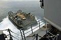 US Navy 050712-N-9866B-001 A Landing Craft, Air Cushion, assigned to Assault Craft Unit Five (ACU-5), backs out of the well deck of the amphibious assault ship USS Peleliu (LHA 5).jpg