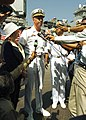 US Navy 051018-N-0716S-015 Commanding Officer, USS Pearl Harbor (LSD 52), Cmdr. Jonathan Harnden, center, and U.S. Consular General to Pakistan, Mary Witt, left, speak to Pakistani media.jpg
