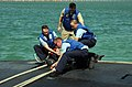 US Navy 051025-N-9288T-036 Sailors secure a mooring line to the Los Angeles-class fast attack submarine USS Annapolis (SSN 760).jpg
