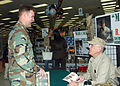 US Navy 060108-N-3560G-008 Builder 3rd Class Robert May, assigned to Naval Mobile Construction Battalion Four (NMCB-4), receives an autograph from R. Lee Ermey.jpg