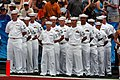 US Navy 060212-N-8157C-009 Sailors' stationed at various commands in Hawaii stand at parade rest waiting to assist in carrying the American Football Conference (AFC) flag during the pre-game show.jpg