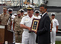 US Navy 060828-N-7163S-006 Chief of Naval Personnel, Vice Adm. John C. Harvey Jr. presents Cleveland Mayor Frank G. Jackson with a plaque recognizing the Mayor's support for Cleveland Navy Week.jpg