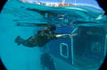US Navy 061129-N-5169H-363 A U.S. Marine from Golf Company, 2nd Battalion, 1st Marine Regiment swims away from a sinking modular amphibious egress trainer during annual swim qualifications.jpg
