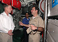 US Navy 070509-N-1522S-008 Commanding Officer of Peruvian navy submarine Chipana (SS-34), Cmdr. Alessandro Mogni, talks with Mayport Naval Station's Public Affairs Officer Bill Austin about the German-made diesel electric subma.jpg