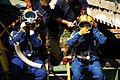 US Navy 070807-N-4515N-519 Navy divers from Mobile Diving and Salvage Unit (MDSU) 2 from Naval Amphibious Base Little Creek, Va., prepare to enter the water at the site of the I-35 bridge collapse.jpg