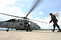 US Navy 080628-N-0640K-031 Members of the Armed Forces of the Philippines (AFP) load an HH-60H Seahawk assigned to the.jpg