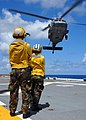 US Navy 080914-N-8132M-004 Aviation Boatwain's Mates (Handling) direct an MH-60S Sea Hawk helicopter assigned to the.jpg