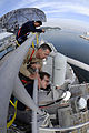 US Navy 081029-N-7280V-085 Capt. Thom W. Burke performs a maintenance spot check with Electronics Technician Seaman Brian Maples.jpg